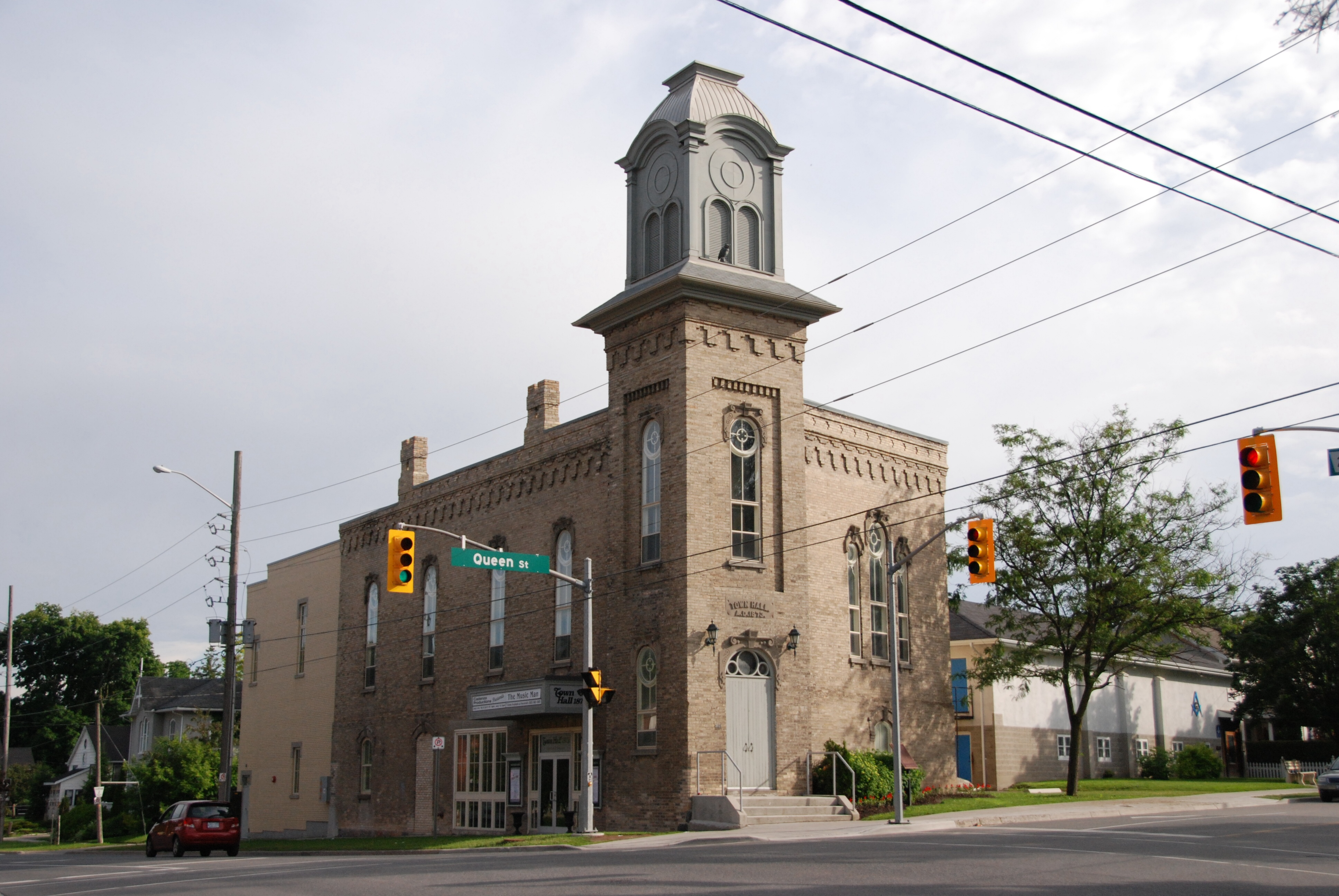 Large brick building with bell tower