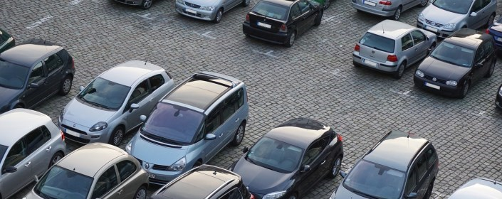 Picture of parking lot with multiple cars in it
